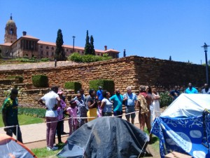 Speaking to a crowd that came to Union Buildings about the protest
