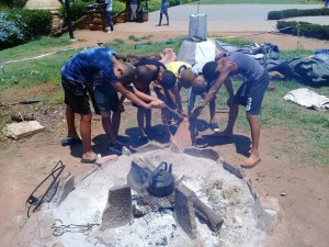 KhoiSan children came to visit here they are paying respects to the Eland